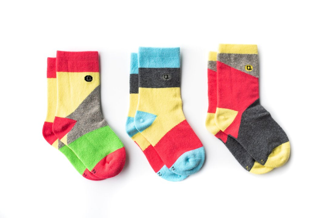 Multi colour mismatched socks made of combed organic cotton