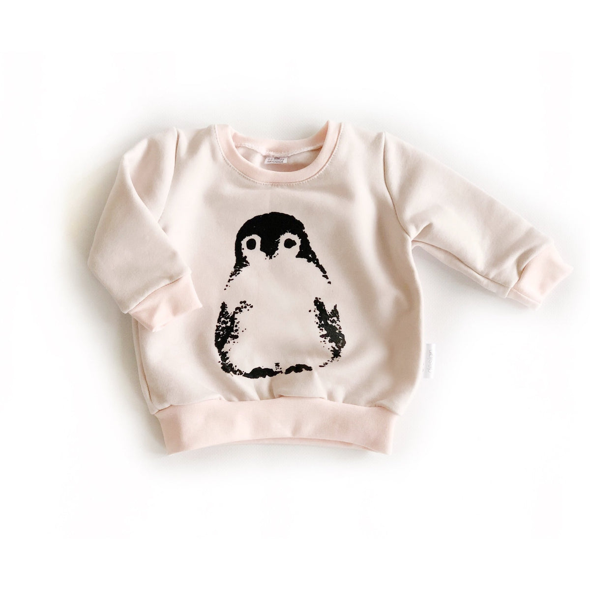 Pink sweatshirt with a penguin handcrafted using luxuriously soft premium lyocell  and organic cotton fleece.