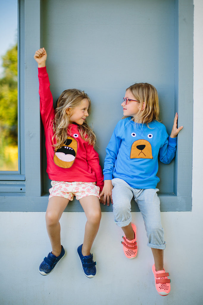 Girls modeling Tootsa Macginty kids BEAR Zip Mouth Organic Cotton Sweatshirt in Bright Red. Ethically made in India.
