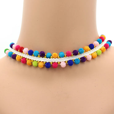 Classic Stretch Velvet Pompom Choker complete your outfit with a little fun colour