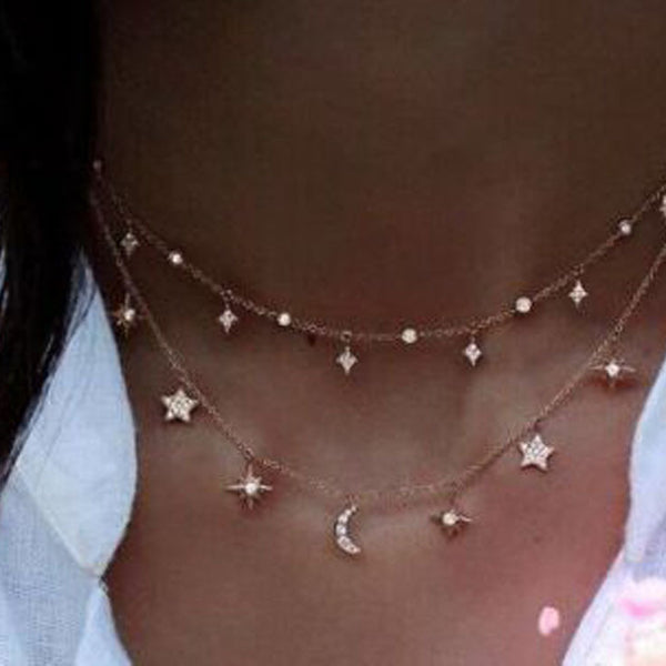 Really dainty moon and start layered necklace