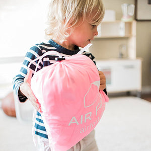 Image of child holding AirFort storage case