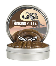 Image of open tin of Dino Poop Thinking Putty