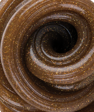 Image of a swirl of brown and sparkly Dino Poop Thinking Putty