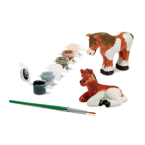 Image of painted horse figurines and craft kit components