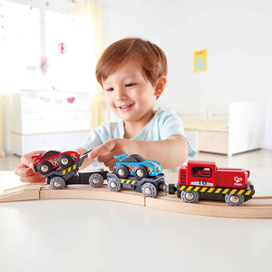 Image of child playing with Hape Race Car Transporter