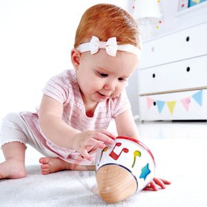 Image of child playing with Rotating Music Box from Hape