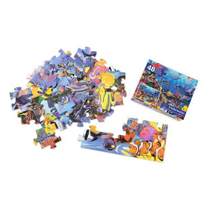 Image of underwater floor puzzle pieces and packaging