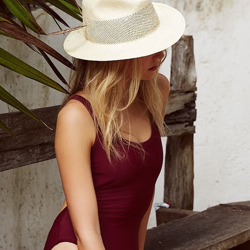 girl wearing woven straw boater hat