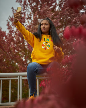 Black Woman Wearing a Yellow Nike Sweatshirt
