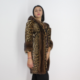 Ocelot coat with hood and mink trimming
