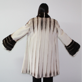 Brown-ivory mink coat with demi-buff trimming