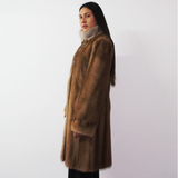 Pastel mink coat with silver collar