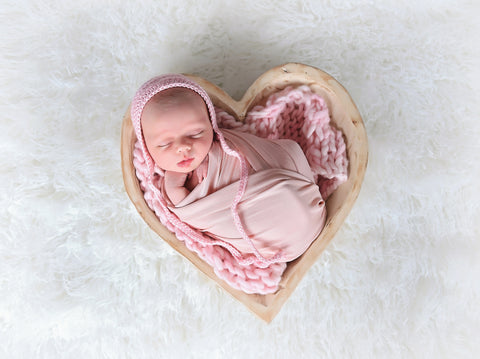 Pale pink newborn baby bonnet by Two Seaside Babes
