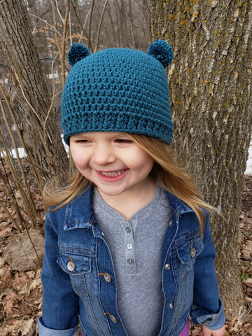 Teal mini pom pom hat by Two Seaside Babes