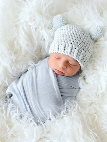 Pale blue mini pom pom hat by Two Seaside Babes