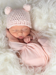 Pale pink mini pom pom hat by Two Seaside Babes
