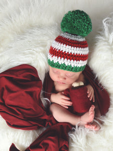 Red & white striped Christmas hat with giant green pom pom by Two Seaside Babes
