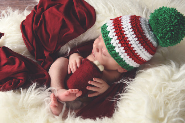 Red & white striped Christmas hat with giant green pom pom