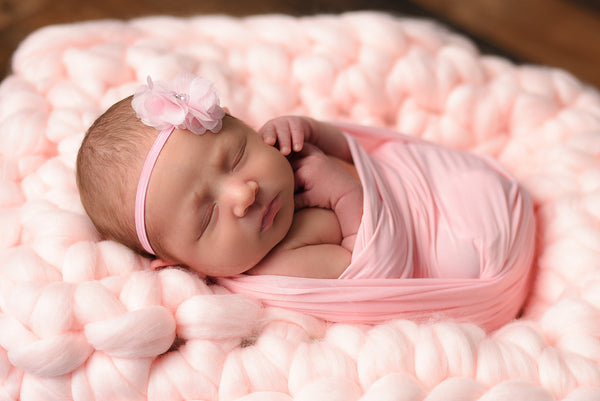Pale pink newborn photo prop chunky bump blanket
