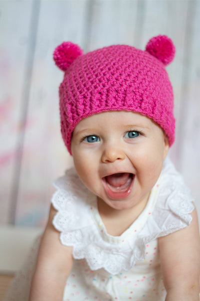 Dark pink mini pom pom hat