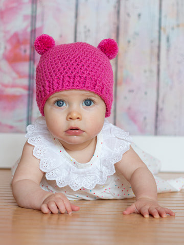 Dark pink mini pom pom hat by Two Seaside Babes