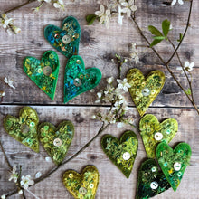Fabric heart brooches in greens