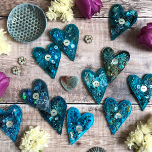Fabric heart brooches in blues