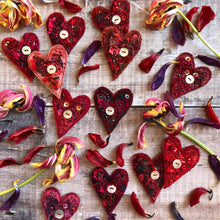 Fabric heart brooches in reds