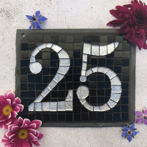 Silver foil number with a black background