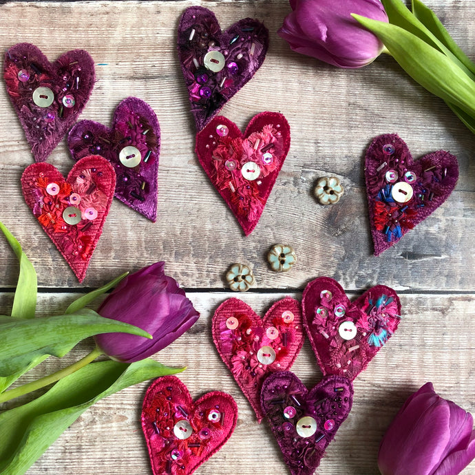 Fabric heart brooches in pinks