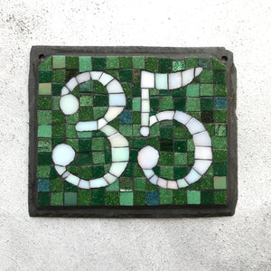 White iridescent number with a dark green background
