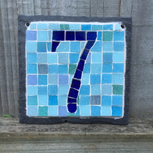 Dark blue iridescent number with a pale blue background