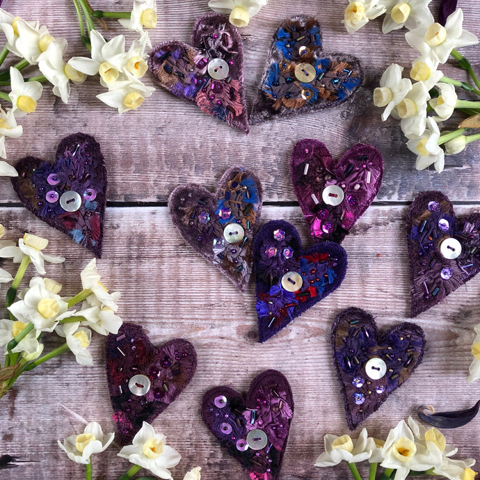 Fabric heart brooches in purples