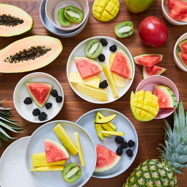 How color affects your baby imagery. Fresh fruit on neutral colored plates.