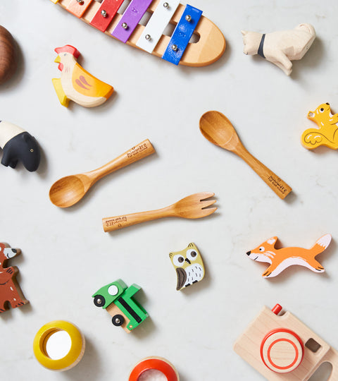 Miniware and toys displayed for meaningful gifts for new parents