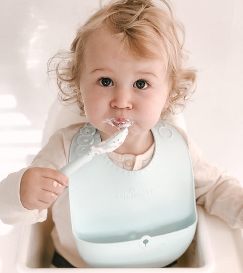 Miniware's Roll & Lock silicone Bib Takes (Some) of the Mess Out of Self-Feeding Training