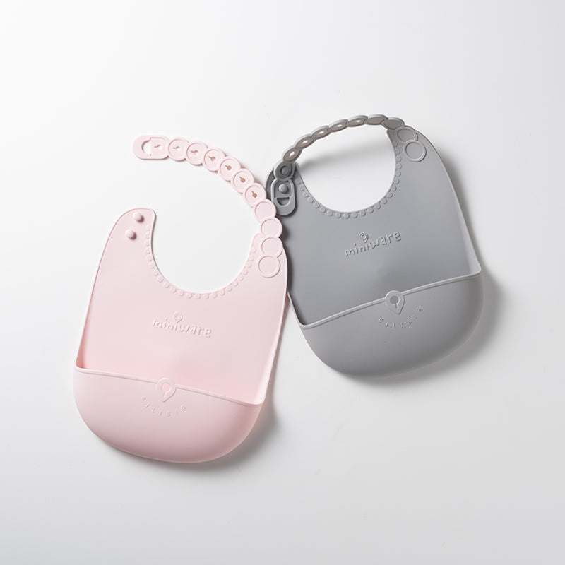 Roll & Lock bib Cotton Candy + Dove Grey