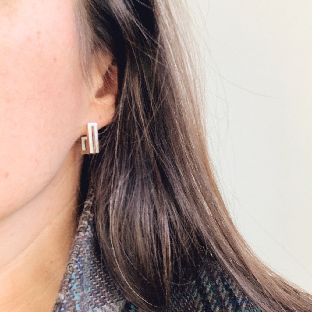 Erin Keary wearing double J earrings
