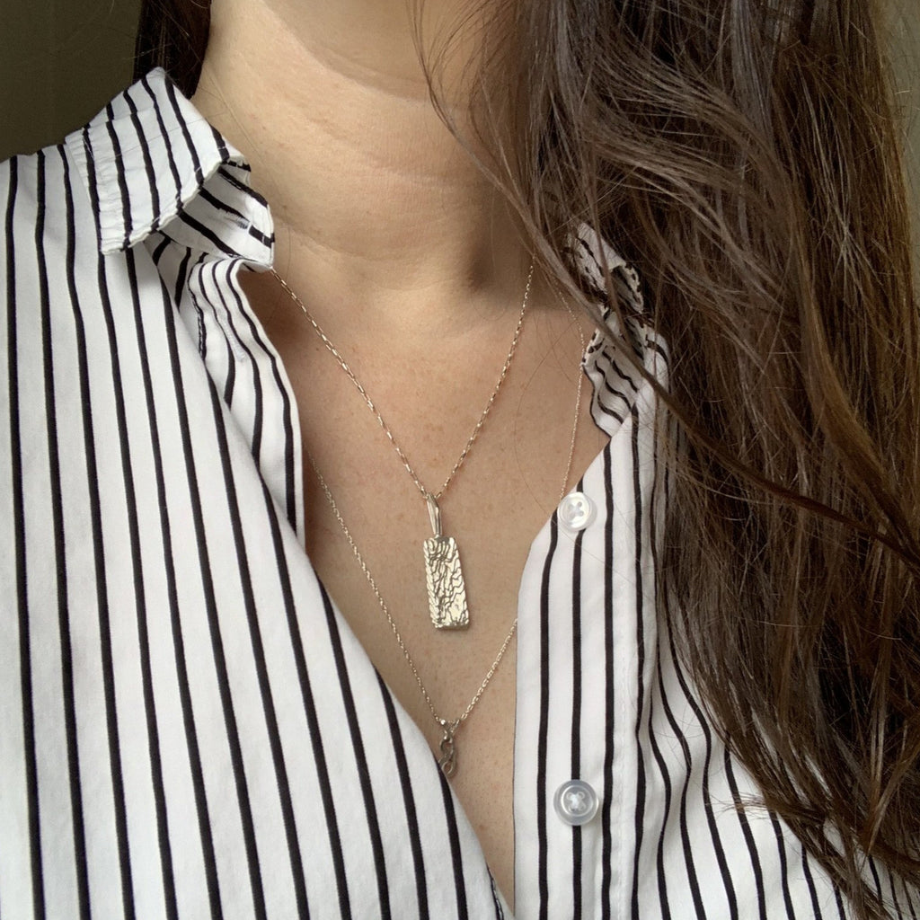 Erin Keary wearing the solid sterling silver ripple pendant on 18 inch sterling silver rolo chain.