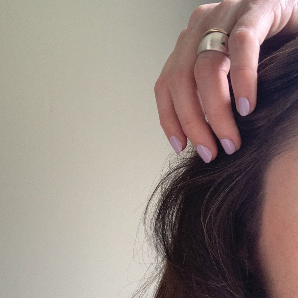 Erin Keary wearing the dome ring with Montana sapphire