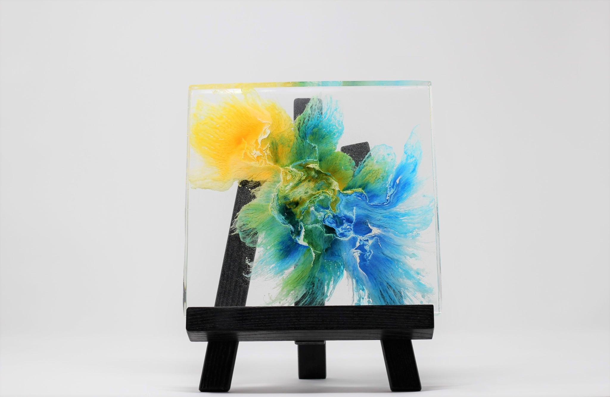 abstract resin art in a blue and yellow color theme transparent