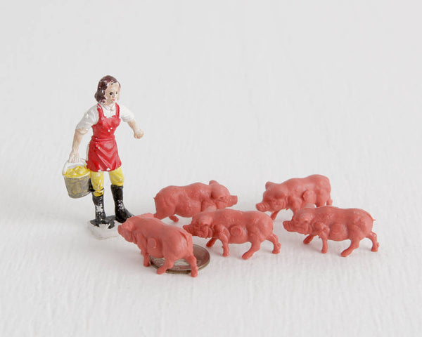 Woman with Five Pink Piglets at Lobster Bisque Vintage