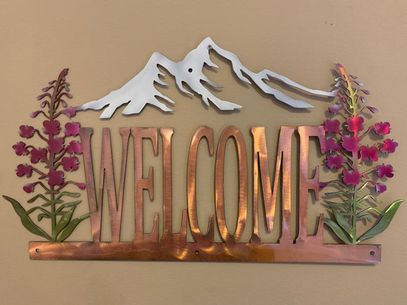"""Welcome"" Sign with Fireweed and Mountains"