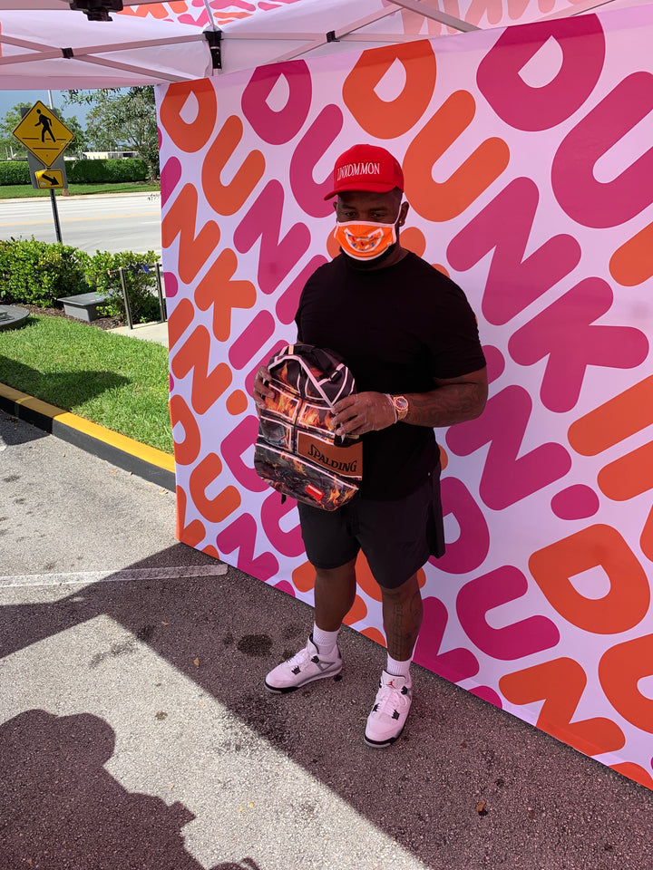 Dolphins' Davon Godchaux teams up to donate Sprayground backpacks to 150 kids
