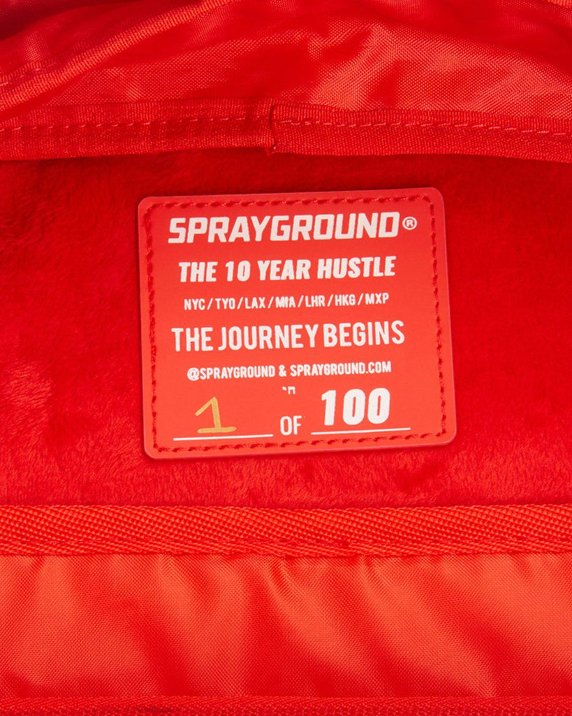 THE 10 YEAR HUSTLE BACKPACK. MYSTERY BOX. NUMBERED 1 OF 100