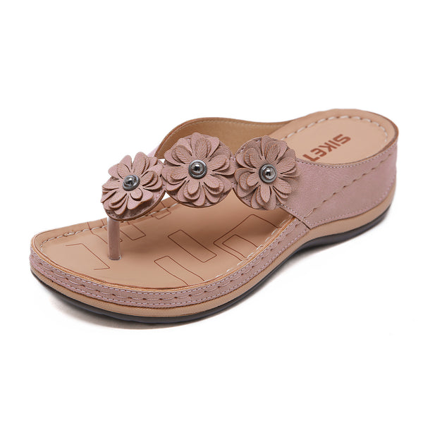 Stereoscopic flower wedge flip flops