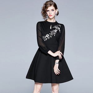 Mock neck embroidered little black dresses