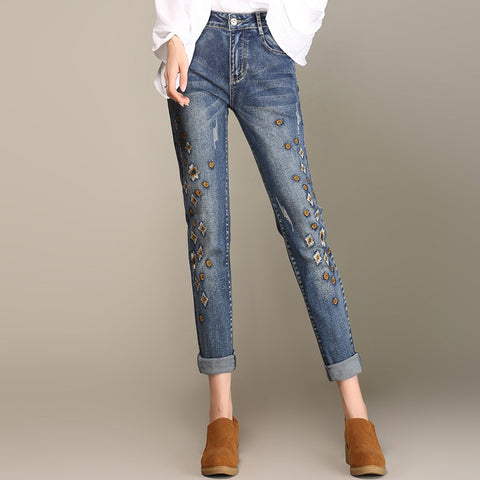 Plus size embroidered denim skinny pants