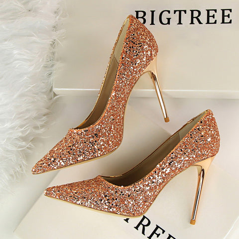 Pointed tor sequin low-fronted heels